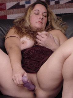 Big Woman Using a Vibrator