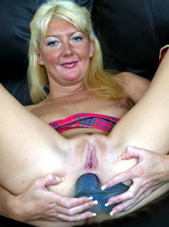 Older woman with dildo up her arse
