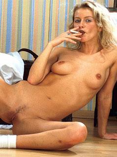 Naked blonde smoking lady